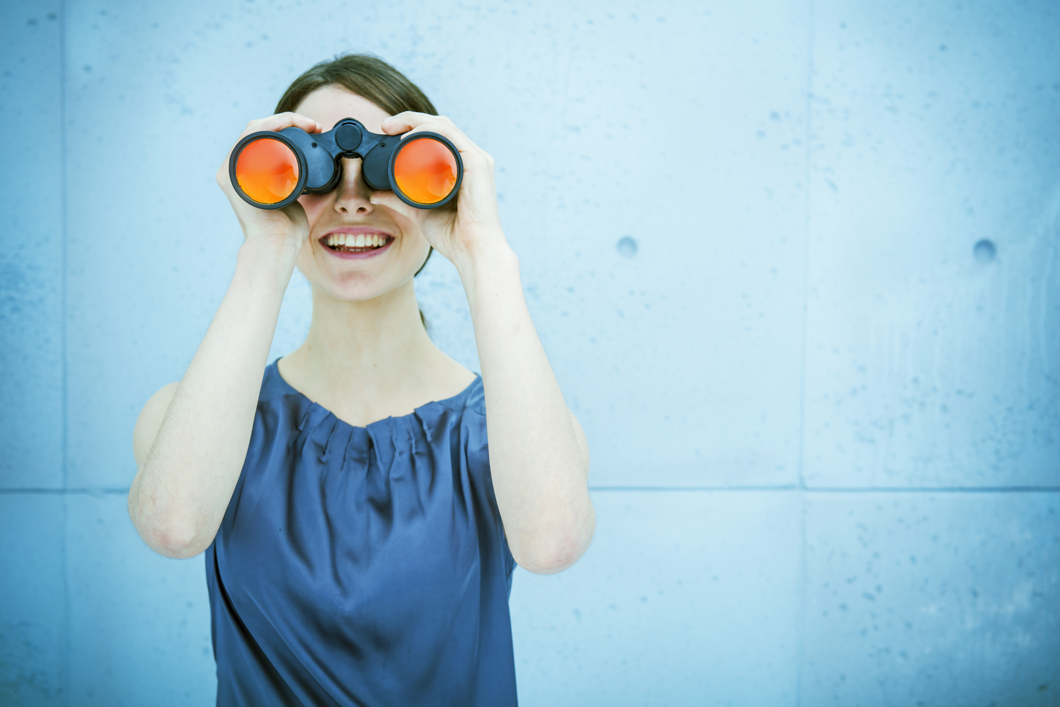 Business vision: woman holding binoculars
