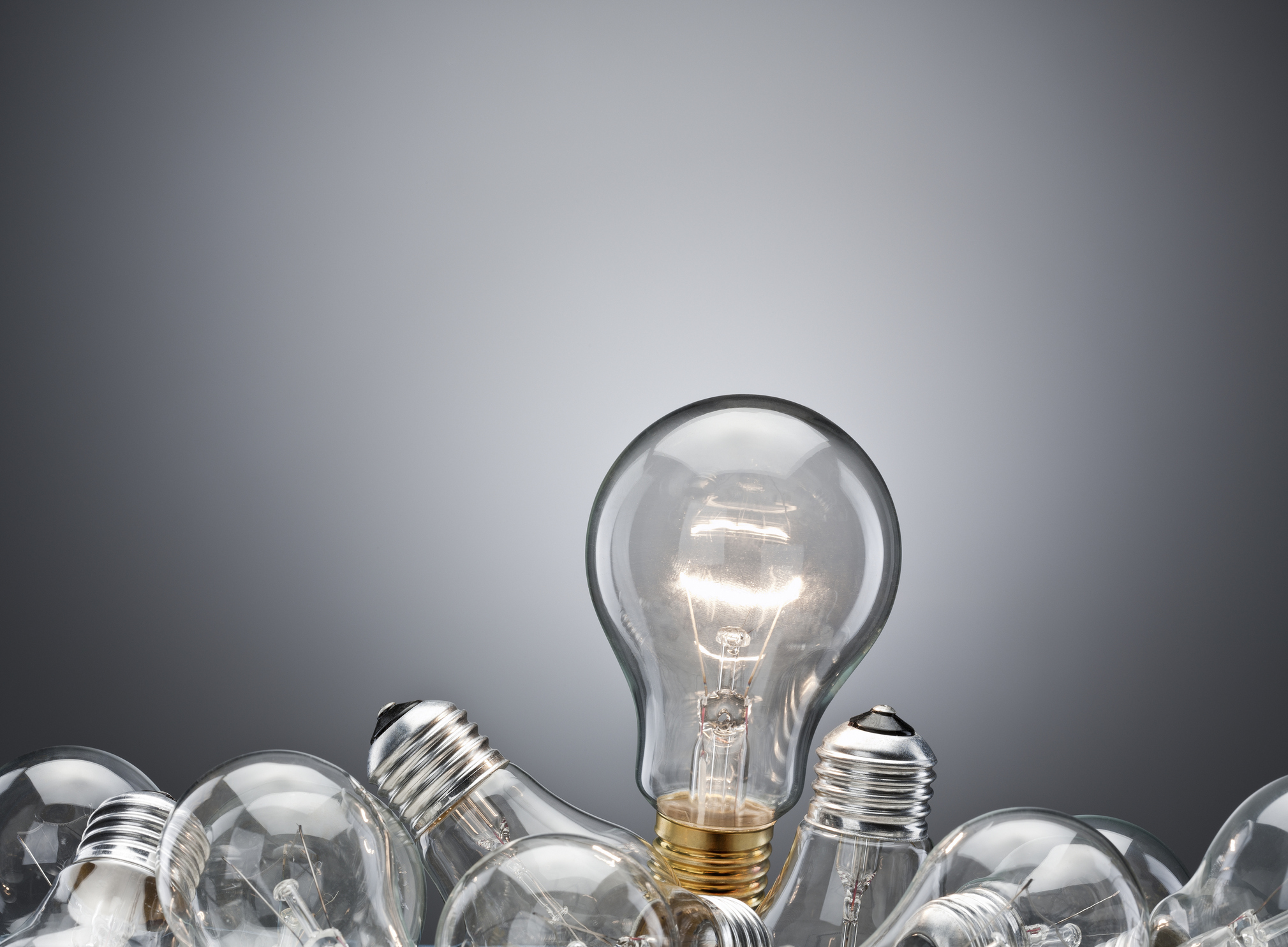 Illuminated light bulb in pile