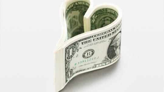 Dollar bills in heart shape